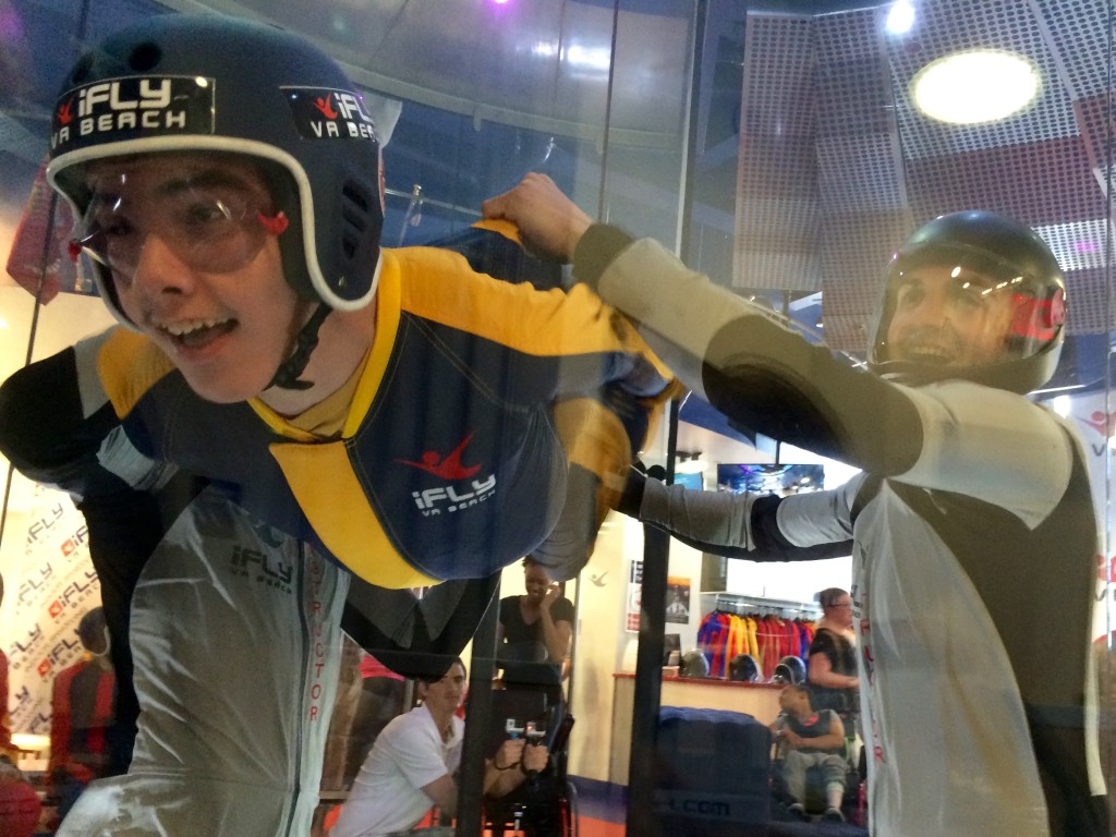 "John, 17, who lives at St. Mary's Home, flies in the indoor wind tunnel at iFLY Va Beach during the ""Soar with St. Mary's"" special event on May 30."