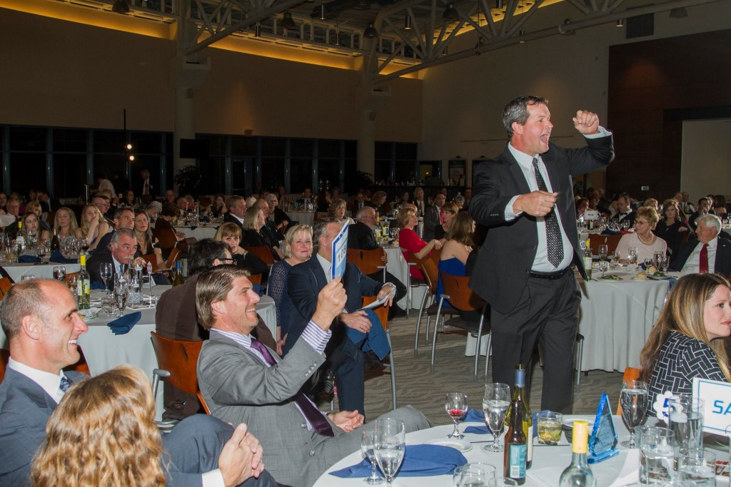 Guests enjoyed bidding on a variety of prizes during an exciting live auction that was a highlight of the Auxiliary Board of St. Mary's 11th annual Gala and Auction on April 16 at The Half Moone Cruise & Celebration Center on Norfolk's downtown waterfront. (photo courtesy Hampton Roads Photography)