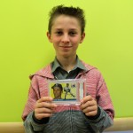 Ty Kraly holds the baseball card of his grandfather, former Yankees pitcher Steve Kraly.